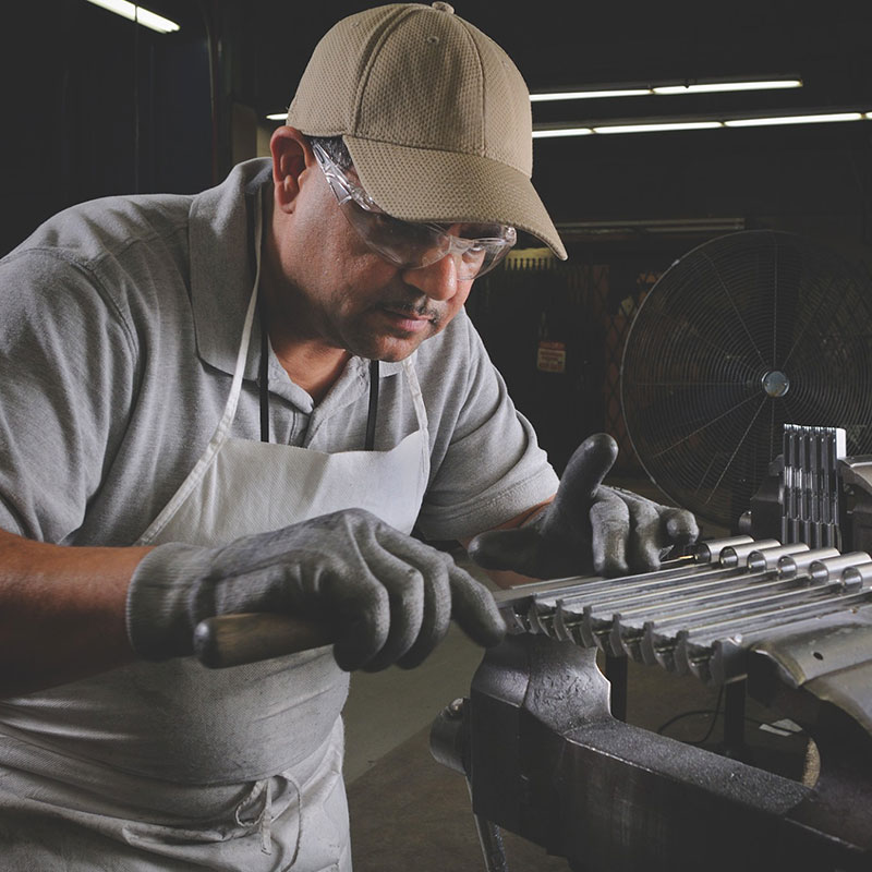 A craftsman in a firearms manufacturing facility