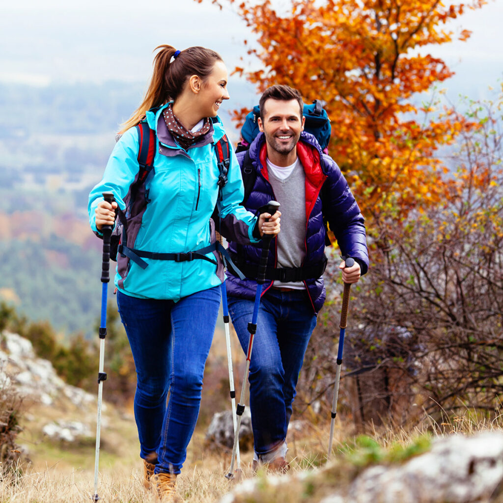 Two people hiking in the fall