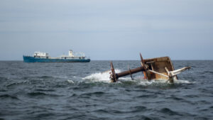 An artificial reef made of a retired ship sinking into the ocean